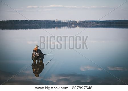 Landscape With A Fisherman On The Lake Senej, Russia.