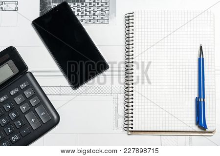 Work Space With Notepad, Pen, Calculator, Smartphone, On White Background. Top View, Flat Lay.