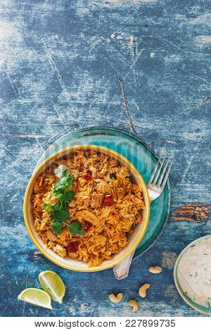 Indian Biryani Rice Dish With Chicken Meat, Curry, Cashew Nuts And Saffron. Top View, Blank Space, R