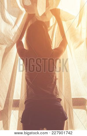Silhouette Of A Girl While Waking Up In The Room.