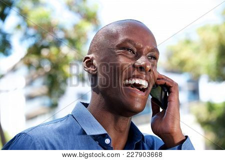 Close Up Laughing African American Businessman Talking On Cellphone