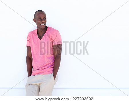 Cool African American Man Smiling By White Wall
