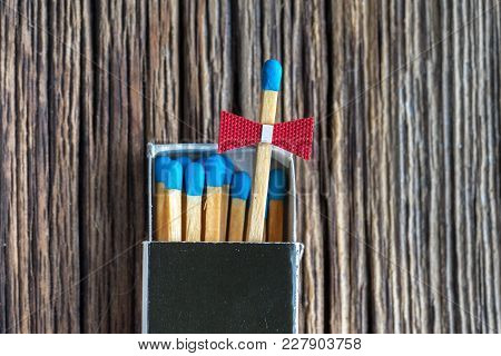 A Bunch Of Blue Safety Matches On Old Wooden Textured Background, Copy Space