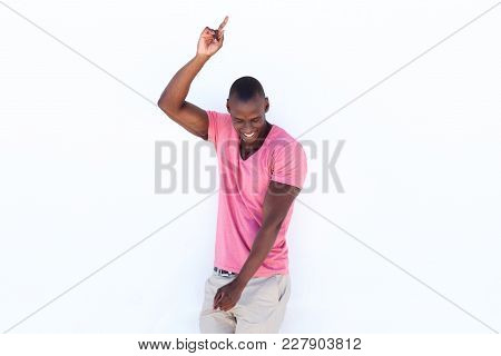 Cheerful African American Man Pointing Fingers At Copy Space On White Background
