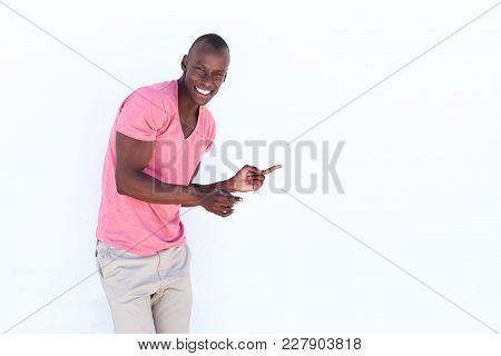 Cheerful African Man Pointing Fingers At Copy Space On White Background