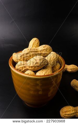 Peanuts, Arachis Hypogaea, In Shell On Dark Background, Close Up, Selective Focus