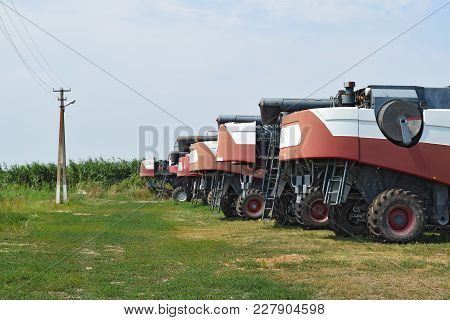 Combine Harvesters, Standing In A Row. Agricultural Machinery. Parking Of Agricultural Machinery.