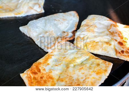 Indian Roti Or Bread Being Baked On The Pan