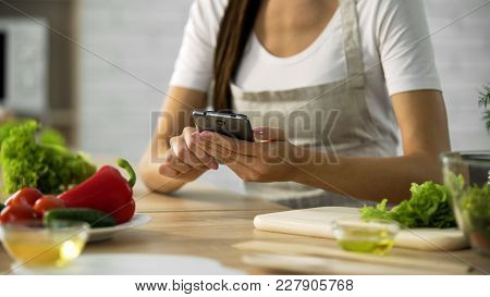 Woman Choosing Salad Recipe On Smartphone At The Kitchen, Cooking Application, Stock Footage