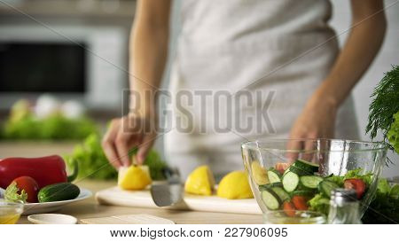 Cooking Amateur Making Fresh Salad At Home Kitchen, Dressing With Lemon Juice, Stock Footage
