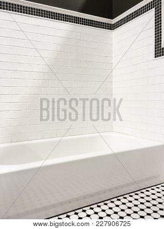 Clean And New Modern Bathroom With White Ceramic Tile Walls.