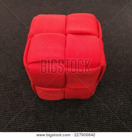 Red Cube Chair On Gray Carpet Floor. Modern Design Furniture.