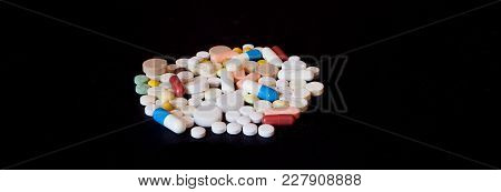 Pharmacy Background On A Dark Table. Levitation Pills. Tablets On A Dark Background Which Falling Do