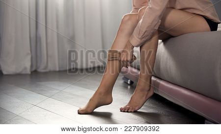 Girl Dressing Pantyhose On Her Slender Legs Sitting In Bedroom, Going To Work, Stock Footage