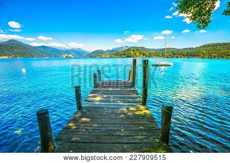 Orta Lake Landscape. Wooden Pier Or Jetty And Orta San Giulio Village And Island, Piedmont, Italy, E