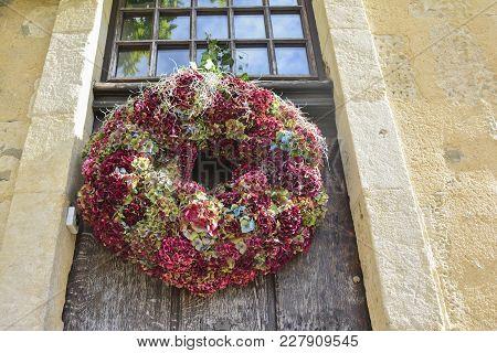Multi-colored Hydrangea Wreath On A Wooden Door