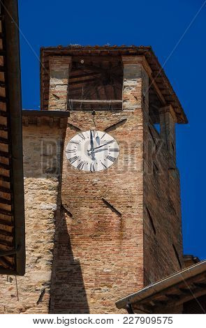 Detail Of The Medieval Clocktower In The Historic Center Of Montone, A Small Town In The Umbria Coun