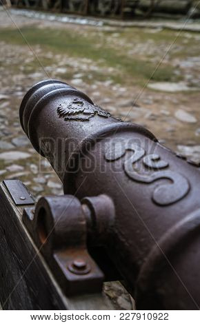 Barrel Of An Old Cannon In The Courtyard Of The Ruins Of The Medieval Bolkow Castle In Lower Silesia