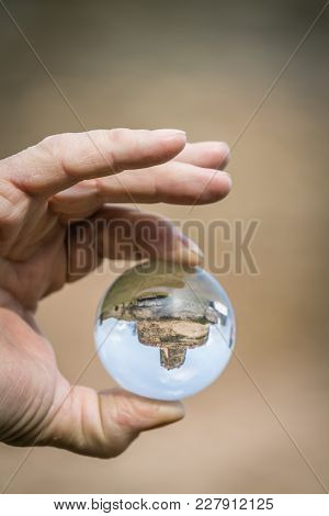 Reflection Of The Ruins Of The Medieval Bolkow Castle In A Crystal Clear Round Glass Ball Held My A