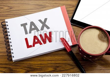 Handwriting Announcement Text Showing Tax Law. Business Concept For Taxation Taxes Rule Written On N