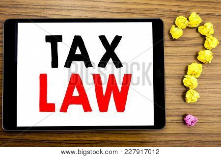 Writing Text Showing Tax Law. Business Concept For Taxation Taxes Rule Written On Tablet Computer On