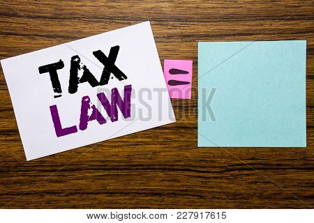 Handwriting Announcement Text Showing Tax Law. Business Concept For Taxation Taxes Rule Written On S