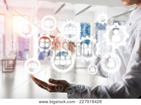 Business Woman In White Shirt Keeping White Social Gear Icons In Hands With Sunlight And Office View