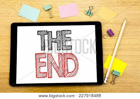 Writing Text Showing The End. Business Concept For End Finish Close Written On Tablet, Wooden Backgr