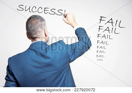 Senior Business Lecturer Writing The Words Success After A Long Stream Of Failures