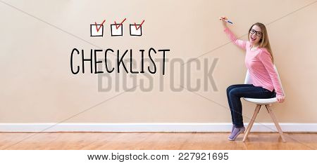 Checklist With Young Woman Holding A Pen In A Chair