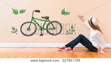 Eco Bicycle With Young Woman Holding A Pen On Floor