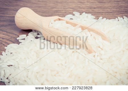 Vintage Photo, Heap Of White Rice With Wooden Scoop, Concept Of Healthy Nutrition