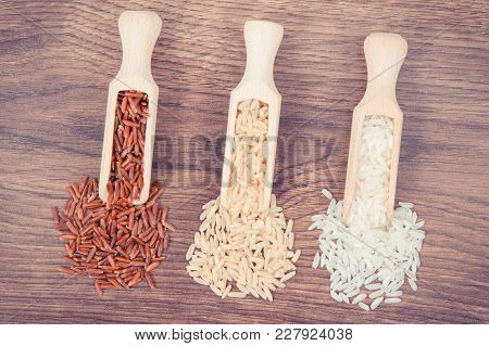 Vintage Photo, Red, Brown And White Rice With Wooden Scoop On Rustic Board, Concept Of Healthy Nutri
