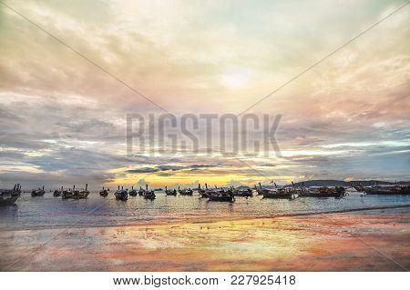 Boats In Sunset On The Ocean Coast In The Gulf Of Thailand
