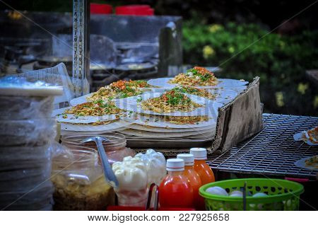 Street Foods In Vietnam With Rice Pancake And Topping With Chicken