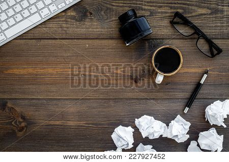 Writer Profession. Retro Concept. Computer, Pen, Inkpot, Coffee Near Crumpled Paper Balls On Dark Wo