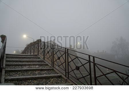 Bridge Over The Water Canal In The Autumn, Haze Weather, Foggy Morning In The National Park.