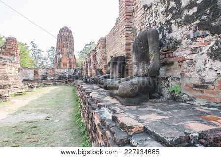 Old Buddha Statue And Ancient Building At Wat Worachet Tharam Temple At Ayutthaya Historical Park In