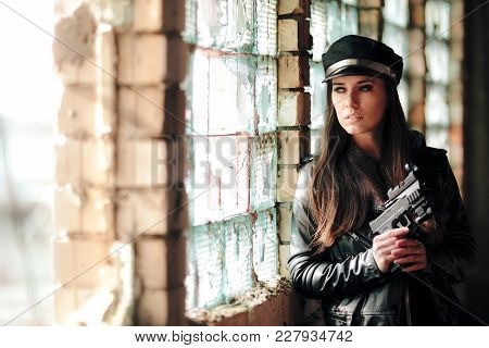 Female Police Officer Holding Gun During Stakeout