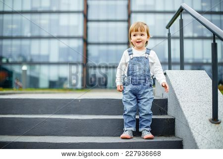 A Small Child On A Walk In The City