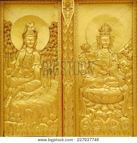 Craft Of Guan Yin Chinese God At The Temple Door In Thailand