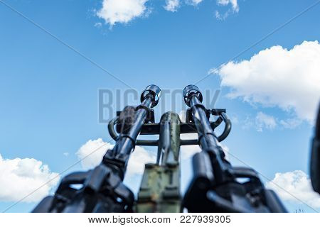 Military Gun Pointing Up Against The Sky