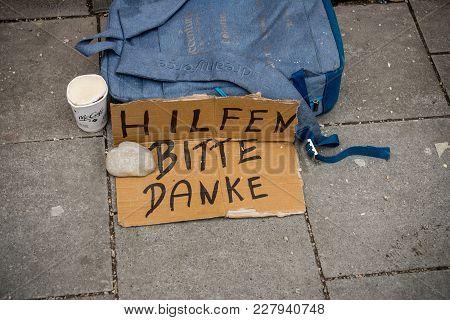 Munich,germany-feb 19,2018:handwritten Beggar Sign In German Asking For Help