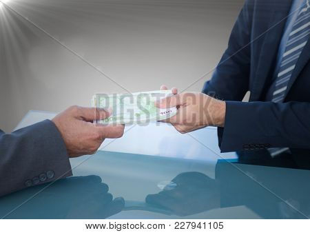 Digital composite of Business money exchange at blue desk against grey background with flare