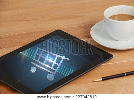 Digital composite of Tablet with Shopping trolley icon and coffee