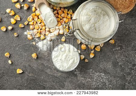 Bowl and jar with corn starch and kernels on table poster