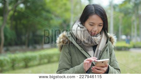 Woman use of mobile phone in the evening