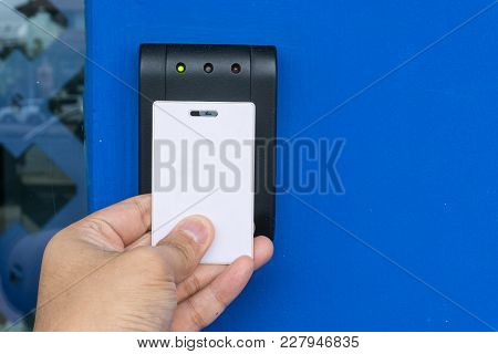Door Access Control - Young Woman Holding A Key Card To Lock And Unlock Door., Keycard Touch The Sec