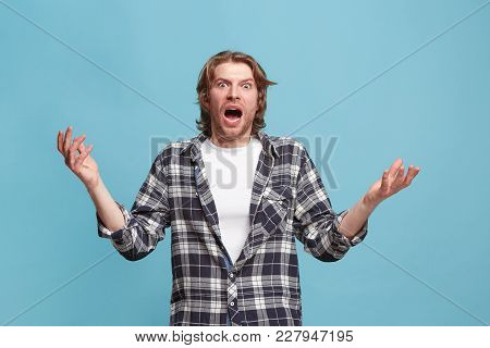 Wow. Attractive Male Half-length Front Portrait On Blue Studio Backgroud. Young Emotional Surprised