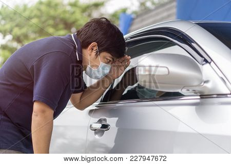 Robber And The Car Thief In A Mask Opens The Door Of The Car And Hijacks The Car., Sick Man With Flu